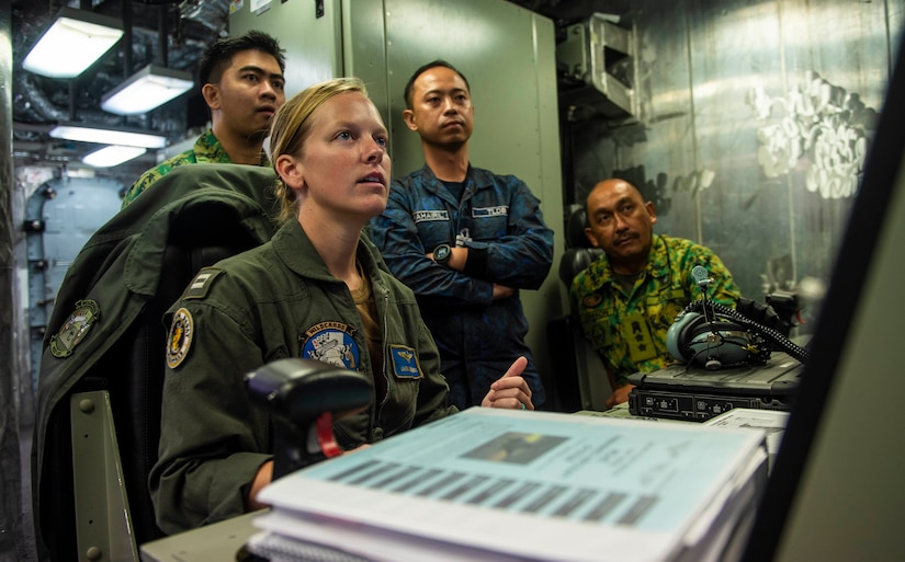 """Lieutenant Laura Burzenski, assigned to """"Wildcards"""" of Helicopter Sea Combat Squadron 23, demonstrates unmanned aerial vehicle MQ-8B Fire Scout capabilities and configurations with Royal Brunei armed forces during Cooperation Afloat Readiness and Training Brunei, South China Sea, October 30, 2019 (U.S. Navy/Christopher A. Veloicaza)"""