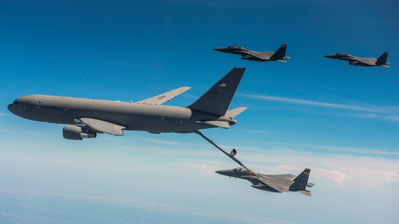 A KC-46 Pegasus from the 916th Air Refueling Wing in-air refuels F-15E Strike Eagles from the 336th Fighter Squadron at Seymour Johnson Air Force Base over the sky of North Carolina.