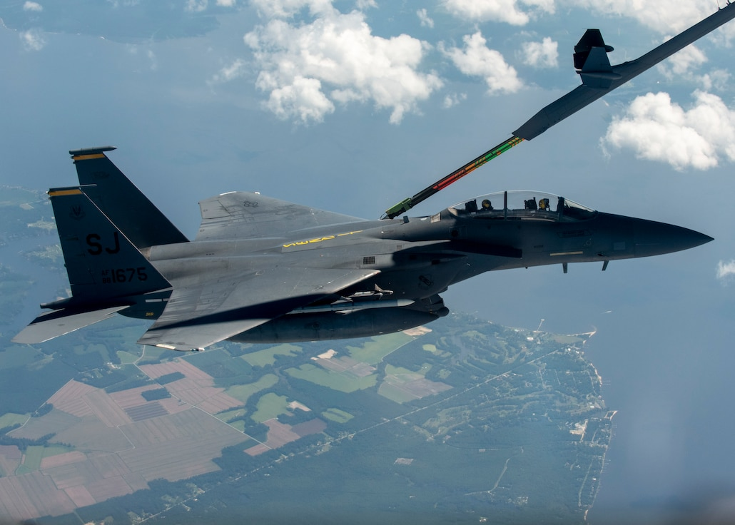 An F-15E Strike Eagle from the 336th Fighter Squadron at Seymour Johnson Air Force Base is in-air refueled by a KC-46 Pegasus from the 916th Air Refueling Wing in the sky over North Carolina.