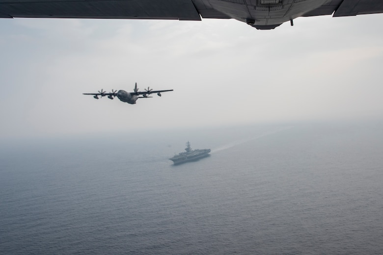 A U.S. Air Force MC-130J soars over the U.S.S. Ronald Reagan off the Northern Coast of Japan, Aug. 5, 2020, during Exercise Gryphon Jet 10. Gryphon Jet is an integrated training exercise focused on improving interoperability throughout the special operations community. During this exercise formation departure, ship based air traffic control procedures, night vision goggle mountain low level, air intercepts with F/A-18s and tilt-rotor air-to-air refueling with the CV-22 were simulated. (U.S. Air Force photo by Airman 1st Class China M. Shock)