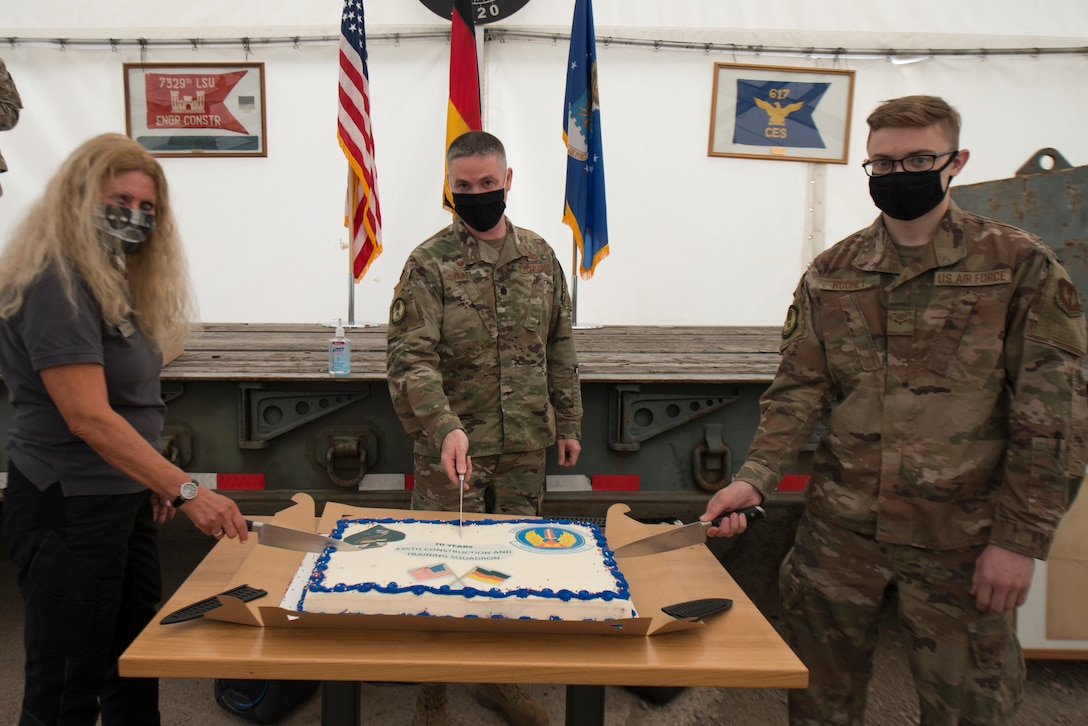 A photo of a cake cutting ceremony