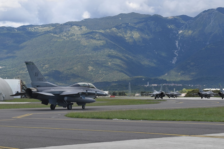 U.S. Air Force Staff Sgt. Devon Kercher, 31st Operations Support Squadron Radar Approach Control senior watch supervisor, and a U.S. Air Force F-16 Fighting Falcon pilot taxi on the flightline at Aviano Air Base, Italy, Sept. 3, 2020. Kercher was recently recognized as the 2019 U.S. Air Forces in Europe Air Traffic Controller of the Year and participated in a familiarization flight. (U.S. Air Force photo by Staff Sgt. Valerie Halbert)
