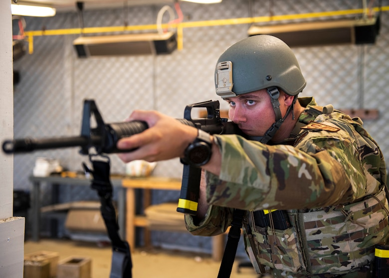 Pennsylvania Air National Guardsman Staff Sgt. Nicholas Yackovich assigned to the 171st Air Refueling Wing's Security Forces Squadron simulates shooting a M4 carbine for a photo Sept. 3, 2020, Pittsburgh, Pennsylvania.  Yackovich recently placed in the Governor's Twenty, took first place with his team at the Adjutant General's Combined Arms Match and first in the team pistol event at the Marksmanship Advisory Council Region 2 Match. (U.S. Air National Guard photo by Senior Airman Zoe M. Wockenfuss)