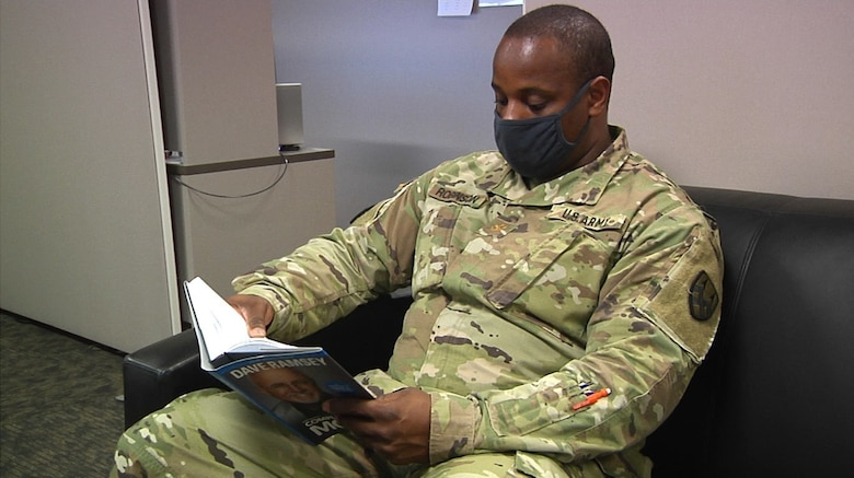 Maj. Henry Robinson, Jr., the senior mobility officer at the 377th Theater Sustainment Command, takes a moment to read a book during his downtime at the headquarters building in Belle Chasse, La., Sept. 2, 2020.