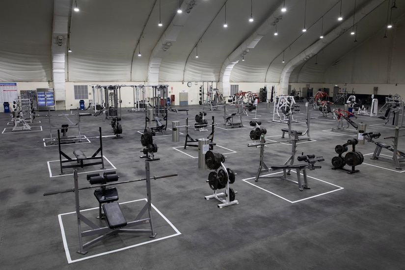A view of equipment spaced for social distancing during a soft reopening of the MWR main fitness center on Camp Buehring, Kuwait, September 3, 2020. The gym's new layout illustrates COVID-19 mitigation measures implemented at the event. (U.S. Amy Reserve photo by Sgt. Khylee Woodford)