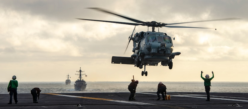 """MH-60R Sea Hawk Helicopter from """"Battlecats"""" of Helicopter Maritime Strike Squadron (HSM) 73 takes off from flight deck of USS Nimitz (CVN 68) during simulated Strait Transit as part of composite training unit exercise, Pacific Ocean, May 14, 2020 (U.S. Navy/Sarah Christoph)"""