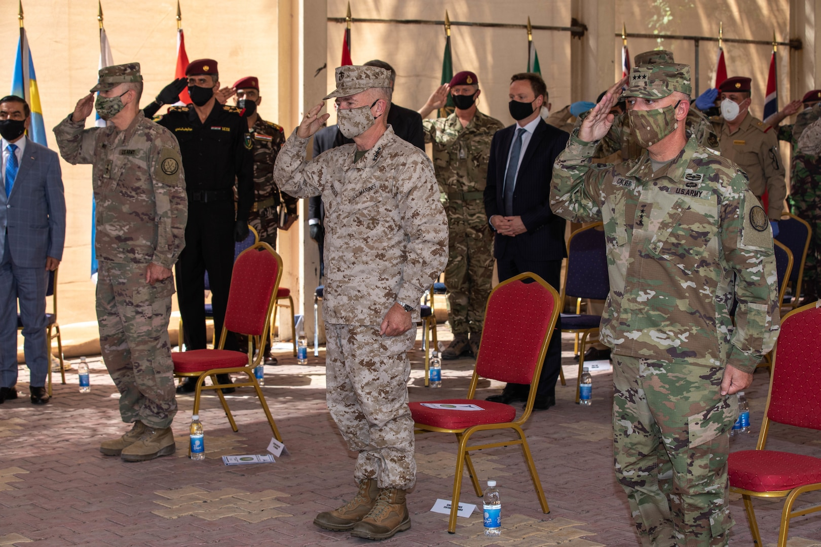 Combined Joint Task Force-Operation Inherent Resolve, the military organization to defeat Daesh in Iraq and Syria, swapped leaders during a change of command ceremony in Baghdad, Set. 9, 2020. Lt. Gen. Paul Calvert (right), Gen. Kenneth F. McKenzie Jr. (central), commanding general, U.S. Central Command, and Lt. Gen. Pat White (left), III Armored Corps commanding general, salute during a ceremony to welcome Gen. Calvert as the new CJTF-OIR commander.
