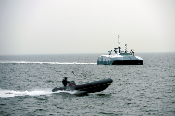 Simulated small boat threats pass by high-speed experimental boat Stiletto so Sailors assigned to Navy Expeditionary Combat Command can observe new technologies in relevant maritime environment, Atlantic Ocean, January 16, 2013 (U.S. Navy)