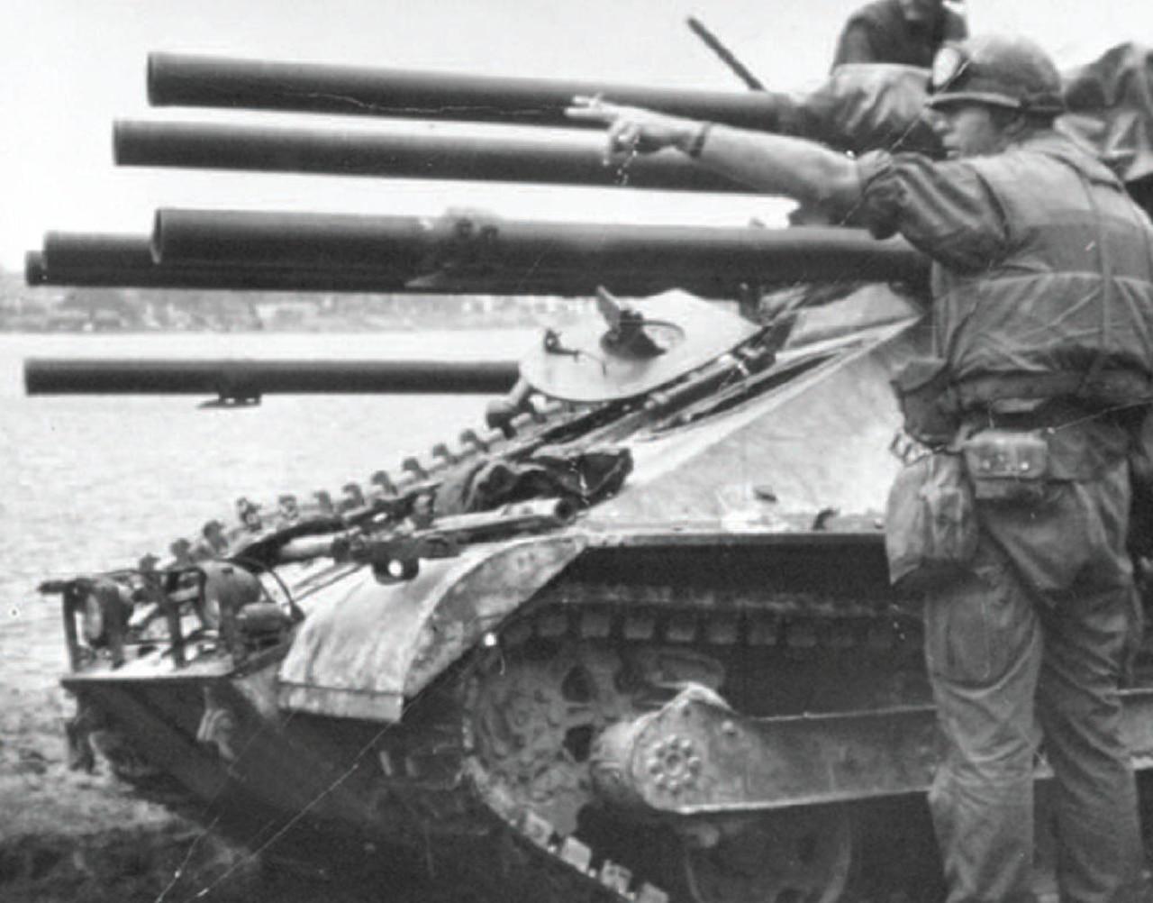 A man directs tank fire.