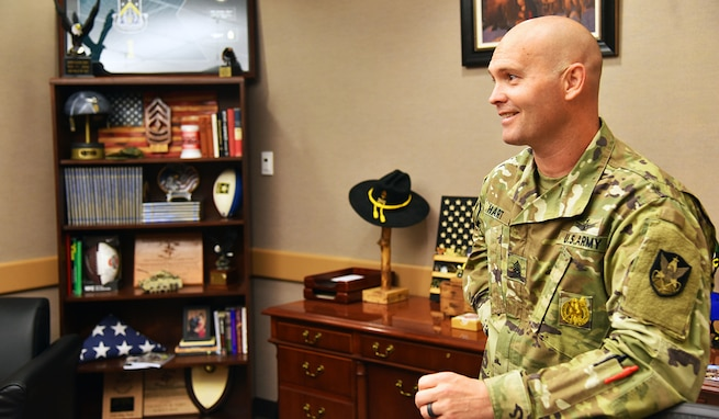 Command Sgt. Maj. Kelly M. Hart, 1st Space Brigade command sergeant major, discusses his leadership philosophy in his office at Fort Carson, Colorado, Sept. 9. Hart assumed responsibility of the brigade in July. (U.S. Army photo by Staff Sgt. Aaron Rognstad/RELEASED).