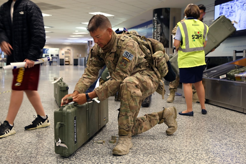 Master Sgt. Gary Keller, an Alaska Air Guardsman with the 176th Security Forces Squadron secures his luggage at Ted Stevens-Anchorage International Airport upon his return from Kandahar, Afghanistan on June 22, 2020. 12 AKNG Airmen deployed in support of Operation Freedom Sentinel, a NATO-led continuation of the Global War on Terrorism. (U.S. Air National Guard photo by Lt. Col. Candis Olmstead/Released)