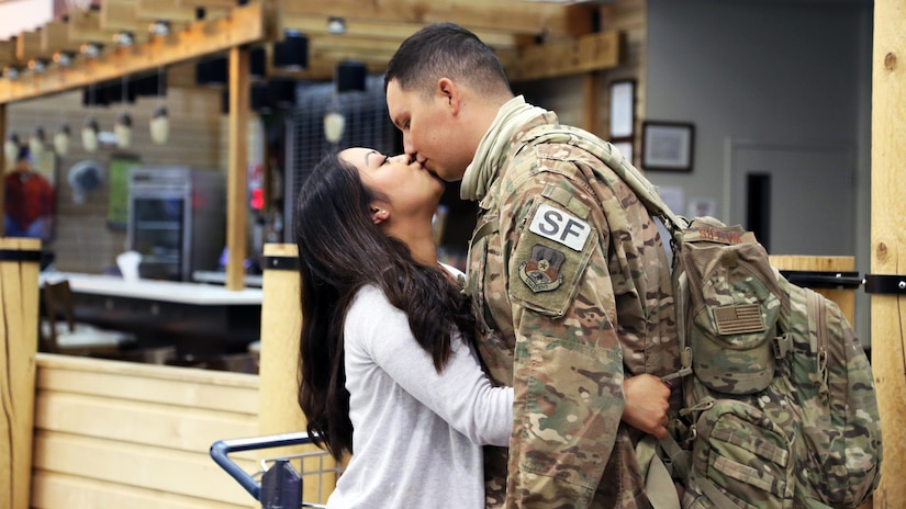 Airman 1st Class Kevin Waters an Alaska Air Guardsman with the 176th Security Forces Squadron shares a loving moment with his partner at Ted Stevens-Anchorage International Airport upon his return from Kandahar, Afghanistan on June 22, 2020. 12 AKNG Airmen deployed in support of Operation Freedom Sentinel, a NATO-led continuation of the Global War on Terrorism. (U.S. Air National Guard photo by Lt. Col. Candis Olmstead/Released)