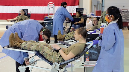 Alaska Department of Military and Veterans Affairs personnel, including National Guardsmen, members of the State Defense Force, and state employees, donate blood to the Blood Bank of Alaska at a mobile center set up in the Guard armory on Joint Base Elmendorf-Richardson, May 26, 2020. Blood donation is essential for hospitals to be able to take care of those who need it. The demand for blood products (blood, platelets and plasma) is constant, even when the world isn't in the midst of a global pandemic. (U.S. Army National Guard photo by Sgt. Seth LaCount/Released)