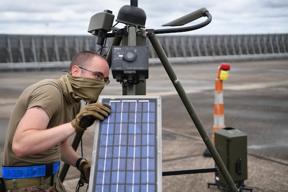Master Sgt. James Gragg, 321st Contingency Response Squadron weather technician, sets up a tactical meteorological observation system during Exercise Swamp Devil at Lake Charles, Louisiana, July 26, 2020. The TMQ-53 is used to observe weather elements and relay information to pilots in real time. (U.S. Air Force photo by Tech. Sgt. Luther Mitchell Jr)