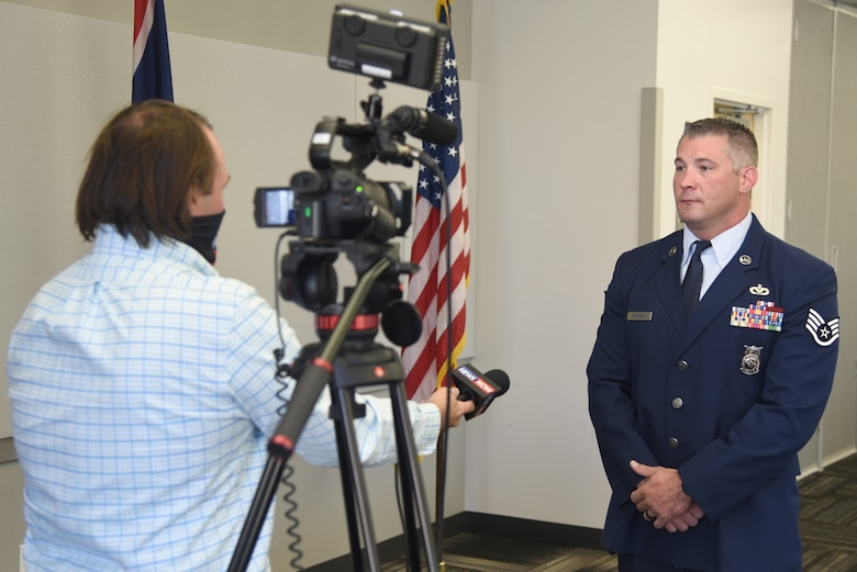 Sergeant McGovern talks to the press