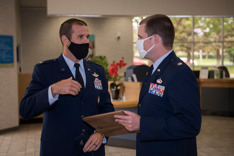 U.S. Air Force Col. Zachery Jiron, left, 60th Air Mobility Wing vice commander, speaks with Lt. Col. Andrew Wilkins, 60th Comptroller Squadron commander, during the 2019 Air Force Distinguished Credit Union Award presentation Sept. 9, 2020, at Travis Air Force Base, California. This marks the second year in a row that Travis Credit Union won this award. (U.S. Air Force photo by Senior Airman Cameron Otte)