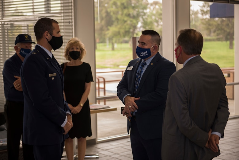 U.S. Air Force Col. Zachery Jiron, left, 60th Air Mobility Wing vice commander, speaks with Barry Nelson, far right, Travis Credit Union president and chief executive officer, and John Evalle, center, Travis Credit Union military affairs officer, during the 2019 Air Force Distinguished Credit Union Award presentation Sept. 9, 2020, at Travis Air Force Base, California. This marks the second year in a row that Travis Credit Union won this award. (U.S. Air Force photo by Senior Airman Cameron Otte)