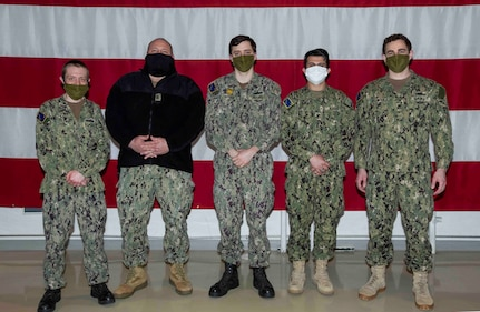 Sailors on State Active Duty Orders for the Alaska Naval Militia pose for a group photo in the National Guard Armory at Joint Base Elmendorf-Richardson, April 14, 2020. (U.S. Navy photo by Mass Communication Specialist Victoria Granado/Released)