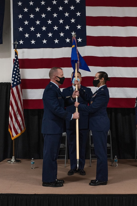 Brig. Gen. David May, Wisconsin's deputy adjutant general for Air, hands over the guide-on to Col. Leslie Zyzda-Martin