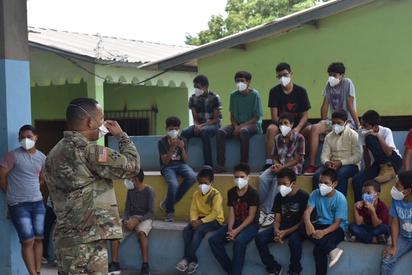 U.S. Army Capt. Joseph Sierra, Joint Task Force-Bravo Headquarters Support Company commander, speaks to a group of Honduran children at the Horizontes al Futuro Orphanage in Comayagua, Honduras, Sept. 5, 2020. Sierra led a team of volunteers to deliver $1000 in charitable donations to the local orphanage, while observing strict COVID-19 protocols to protect all members involved.