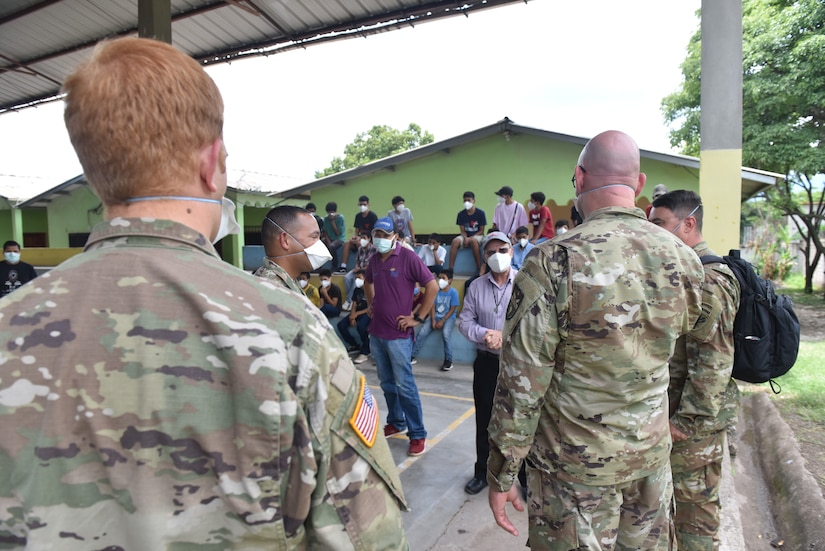 U.S. Army Capt. Joseph Sierra, Joint Task Force-Bravo Headquarters Support Company (HSC) commander, speaks to Father Gregorio about the needs of the Horizontes al Futuro Orphanage in Comayagua, Honduras, Sept. 5, 2020. The HSC sponsors the orphanage, periodically bringing in volunteers to spend recreational time with the children as well as contributing donations. The team took special care to observe strict COVID-19 protocols while conducting the visit for the safety of all involved.