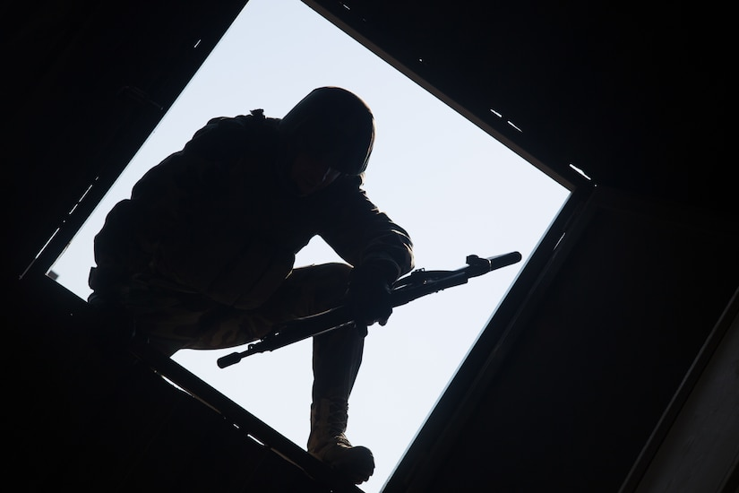 Peshmerga soldier climbs through window during building assault training at Bnaslawa, Iraq, on February 2, 2017, as part of critical training provided by Combined Joint Task Force–Operation Inherent Resolve (U.S. Army/Ian Ryan)