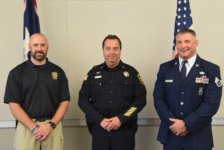 group photo of Chief Kozak and Sgt McGovern and Sgt Bentley
