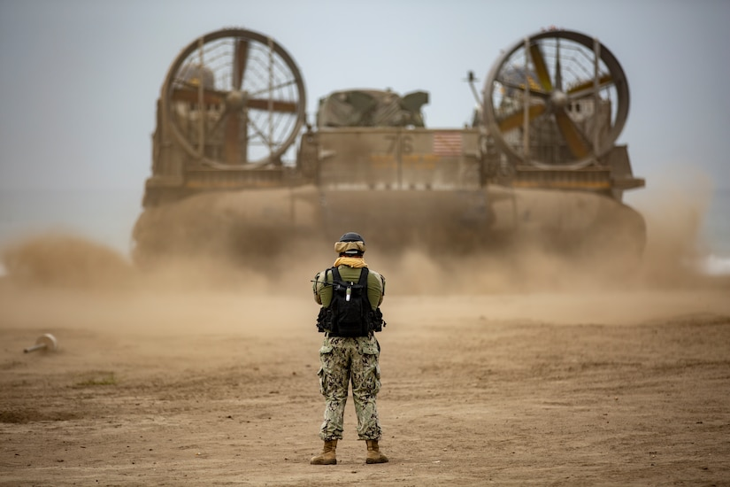Sailor assigned to Assault Craft Unit 5 watches over departure of Landing Craft Air Cushion from Red Beach in preparation for San Francisco Fleet Week, featuring unique training and education program that brings together civilian and military forces, September 27, 2018 (U.S. Marine Corps/Jacob Farbo)