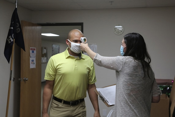 Trainers conduct regular temperature checks on each other during the first virtual Stand for Life suicide prevention training event with 79 suicide prevention liaisons across Army Reserve units throughout the continental U.S.