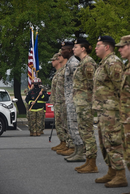 First responder Honor Guard members prepare to post colors during a 9/11 memorial service on Kunsan Air Base, Republic of Korea.
