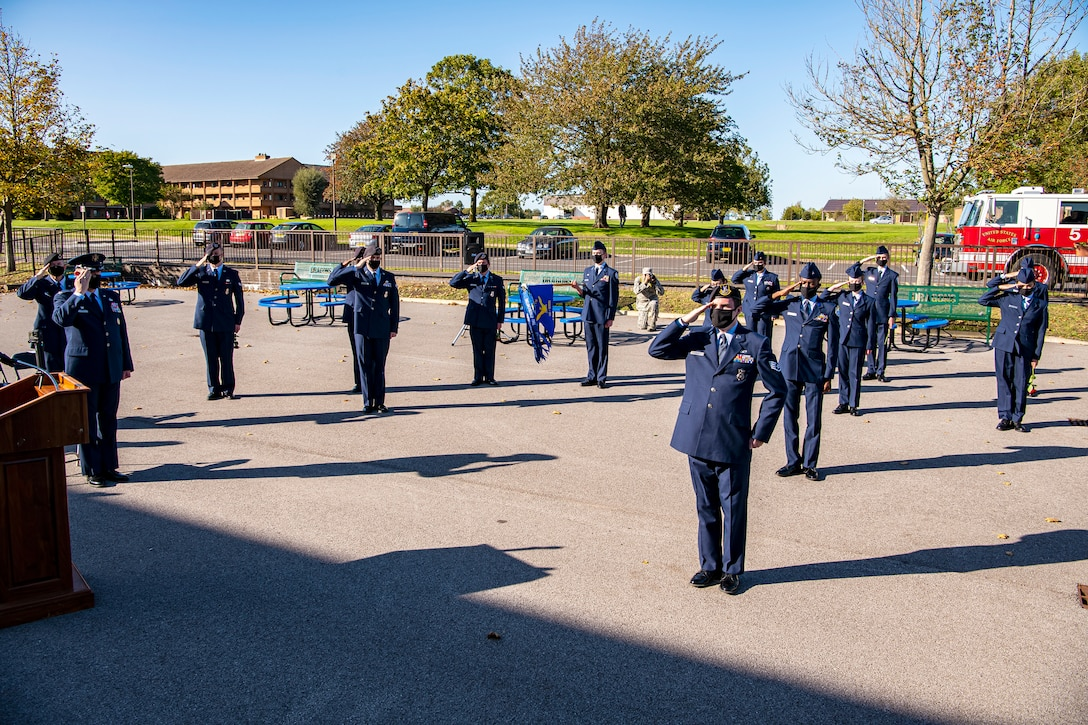 Cadets from the Alconbury Highschool JROTC along with Airmen from the 501st Combat Support Wing, salute during a playing of the national anthem at RAF Alconbury, England, Sep. 9, 2020. Airmen and Cadets participated in the ceremony to honor those who lost their lives during the September 11th terrorist attacks. (U.S. Air Force photo by Senior Airman Eugene Oliver)