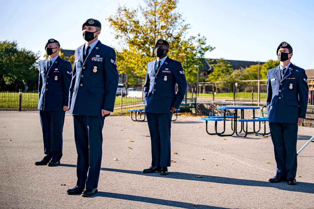Airmen from the 423rd Security Forces Squadron stand at attention during a 9/11 remembrance ceremony at RAF Alconbury, England, Sep. 9, 2020. Airmen from the 501st Combat Support Wing along with cadets from the Alconbury High School JROTC participated in the ceremony to honor those who lost their lives during the September 11th terrorist attacks. (U.S. Air Force photo by Senior Airman Eugene Oliver)
