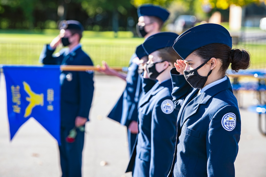 Cadets from the Alconbury Highschool JROTC along with Airmen from the 501st Combat Support Wing, salute during a 9/11 remembrance ceremony, Sep. 9, 2020 at RAF Alconbury, England. Airmen from the 501st Combat Support Wing and Cadets participated in the ceremony to honor those who lost their lives during the September 11th terrorist attacks. (U.S. Air Force photo by Senior Airman Eugene Oliver)