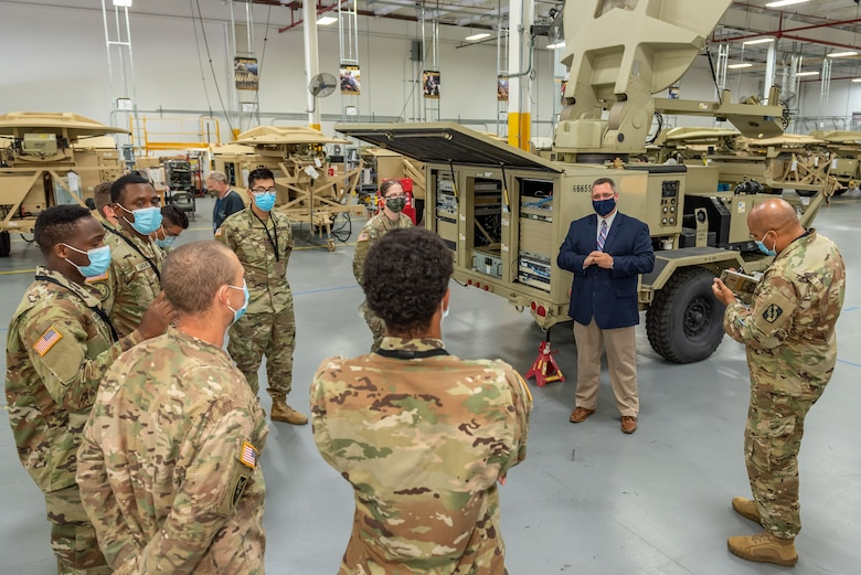 Anthony Brandi, Chief of Tobyhanna's SATCOM System Division, briefs Soldiers on the Satellite Transportable Terminal.