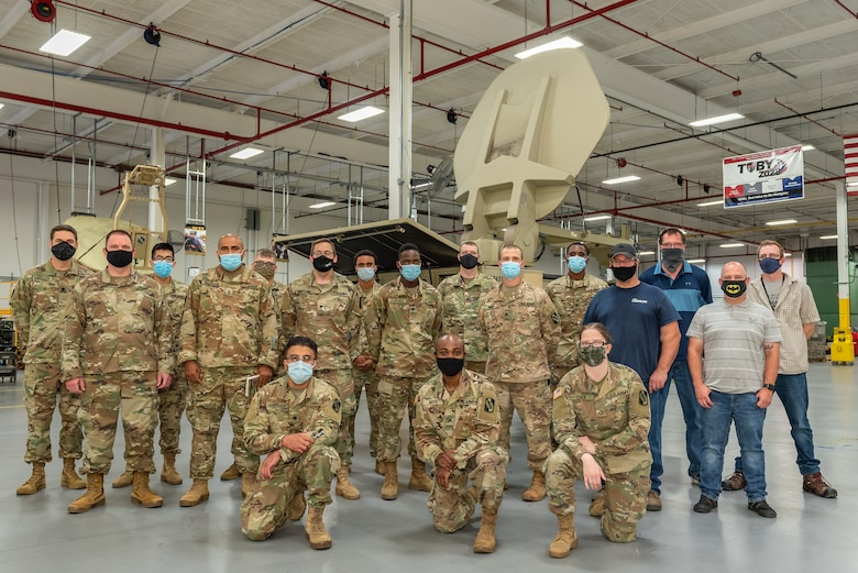"""Tobyhanna Army Depot team members pose with Soldiers from the 392nd Expeditionary Signal Battalion, 359th Theater Tactical Signal Brigade after the conclusion of their """"side-by-side"""" training in August 2020."""