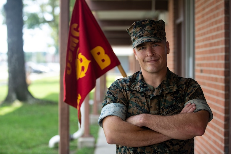 U.S. Marine Corps Capt. Brenden D. McDaniel, commanding officer, Bravo Company, Headquarters and Support Battalion, Marine Corps Installations East-Marine Corps Base Camp Lejeune, poses in front of the Bravo Company barracks on Sept. 3, 2020. On Sept. 11, 2001, McDaniel was a freshman at Concordia College, although he had no plans to join the military at the time, he did see his father, who was active duty Air Force, deploy multiple times because of the terrorist attacks that day. This year marks the 19th anniversary of Patriots Day, which honors the nearly 3,000 American citizens, civil servants, and first responders whose lives were taken as a result of the terrorist attacks that took place on Sept. 11, 2001. (U.S. Marine Corps Photo by Lance Cpl. Isaiah Gomez)