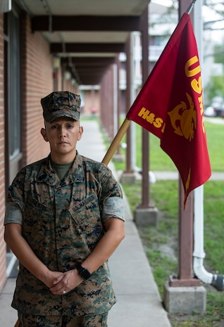 "U.S. Marine Corps 1st Sgt. Esperanza Fuentes, first sergeant, Bravo Company, Headquarters and Support Battalion, Marine Corps Installations East-Marine Corps Base Camp Lejeune, poses in front of the Bravo Company barracks on Sept. 3, 2020. On Sept. 11, 2001, Fuentes was a Lance Cpl. Stationed at Camp Pendleton, California. That day the question on everyone's minds was ""are we deploying?"" The answer, yes, would be one of the many things that led her to where she is now.  This year marks the 19th anniversary of Patriots Day, which honors the nearly 3,000 American citizens, civil servants, and first responders whose lives were taken as a result of the terrorist attacks that took place on Sept. 11, 2001.  (U.S. Marine Corps Photo by Lance Cpl. Isaiah Gomez)"