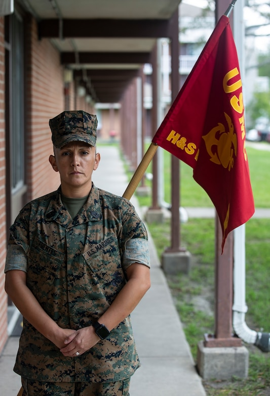 """U.S. Marine Corps 1st Sgt. Esperanza Fuentes, first sergeant, Bravo Company, Headquarters and Support Battalion, Marine Corps Installations East-Marine Corps Base Camp Lejeune, poses in front of the Bravo Company barracks on Sept. 3, 2020. On Sept. 11, 2001, Fuentes was a Lance Cpl. Stationed at Camp Pendleton, California. That day the question on everyone's minds was """"are we deploying?"""" The answer, yes, would be one of the many things that led her to where she is now.  This year marks the 19th anniversary of Patriots Day, which honors the nearly 3,000 American citizens, civil servants, and first responders whose lives were taken as a result of the terrorist attacks that took place on Sept. 11, 2001.  (U.S. Marine Corps Photo by Lance Cpl. Isaiah Gomez)"""
