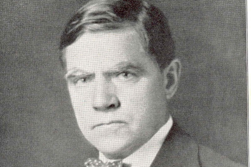 Head shot of a man in a suit and tie.