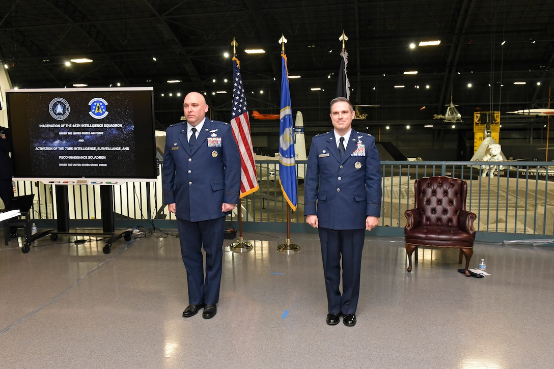 Col. Chandler P. Atwood (left), commander, Space Delta 7, U.S. Space Force, inactivates the 18th Intelligence Squadron and activates the 73rd Intelligence, Surveillance and Reconnaissance Squadron under the command of Lt. Col. Nathaniel A. Peace (right), U.S. Space Force, during a ceremony at the National Museum of the U.S. Air Force at Wright-Patterson Air Force Base, Sept. 3. (U.S. Air Force photo/Ty Greenlees)