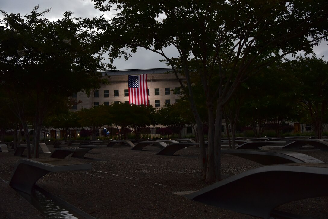 A flag hangs from the side of the Pentagon.