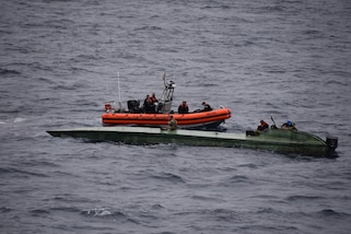 Coast Guard Cutter Bertholf (WMSL-750) crewmembers inspect a low-profile semi-submersible in international waters of the Eastern Pacific Ocean Aug. 14, 2020.