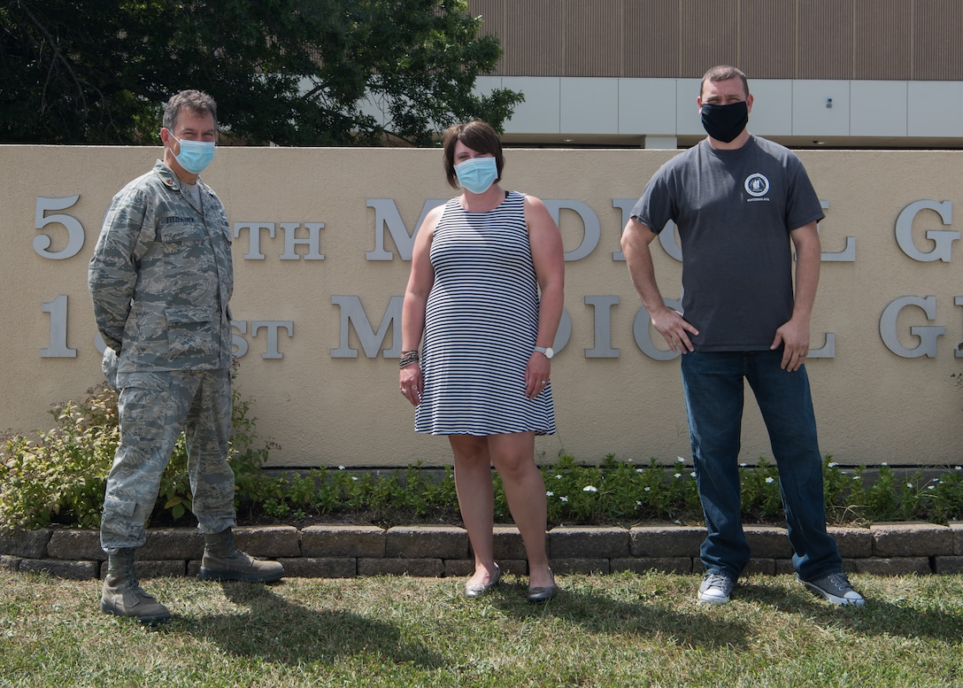 U.S. Air Force Maj. Sean FitzPatrick, a Family Advocacy Officer, left, Bethany Burkhart, a Domestic Abuse Victim Advocate, center, and Cory Watson, a family advocacy intervention specialist, right ,with the 509th Medical Group Family Advocacy Program stand for a photo on August 28, 2020 in front of the 509th MDG Clinic at Whiteman Air Force Base, Missouri. The overall military Family Advocacy Program has the primary goals of preventing abuse, encouraging early identification and prompt reporting, promoting victim safety and empowerment, and providing appropriate treatment for affected service members and their families. (U.S. Air Force photo by Airman 1st Class Parker J. McCauley)