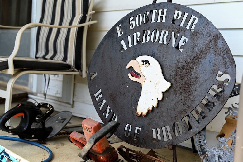 Bradford Freeman, assigned to 'Easy' Company, 2nd Battalion of the 506th Parachute Infantry Regiment of the 101st Airborne Division, has memorabilia on his porch. The popular television show 'Band of Brothers' depicted Freeman and his achievements with the help of many Easy Company team members. (U.S. Air Force photo by Senior Airman Keith Holcomb)