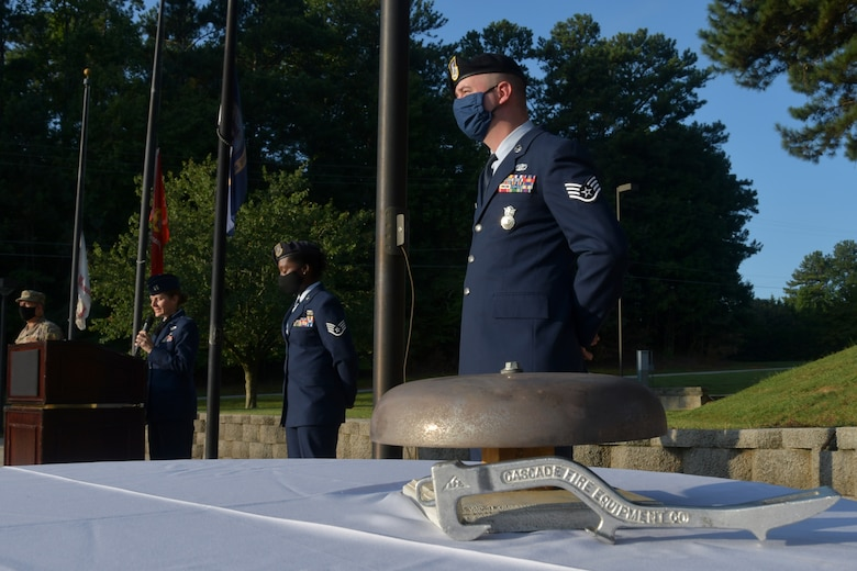 Airmen from the 94th Airlift Wing participate in a 9/11 Remembrance Ceremony at the POW/MIA Memorial at Dobbins Air Reserve Base, Ga. The ceremony included a moment of silence, command commentaries and an honor guard presentation. (U.S. Air Force photo by Senior Airman Shelby Thurman)