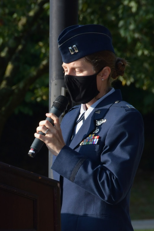 Capt. Latessa Meader, 700th Airlift Squadron pilot, speaks at a 9/11 Remembrance Ceremony at the POW/MIA Memorial at Dobbins Air Reserve Base, Ga. The ceremony included a moment of silence, command commentaries and an honor guard presentation. (U.S. Air Force photo by Senior Airman Shelby Thurman)