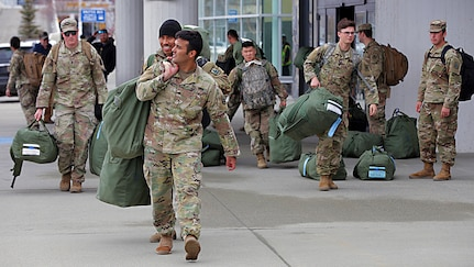 Alaska National Guard Soldiers assigned to 1st Battallion, 297th Infantry Regiment depart Ted Stevens International Airport after returning from a 9 month deployment in Kosovo, Apr 4, 2020. Prior to returning to their home state, the Soldiers were quarantined for 14 days in El Paso Texas, amid the COVID-19 pandemic. (U.S. Army National Guard photo by Sgt. Seth LaCount/Released)