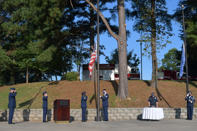 Airmen with the 94th Airlift Wing salute during a 9/11 Remembrance Ceremony at the POW/MIA Memorial at Dobbins Air Reserve Base, Ga. The ceremony included a moment of silence, command commentaries and an honor guard presentation. (U.S. Air Force photo by Senior Airman Shelby Thurman)