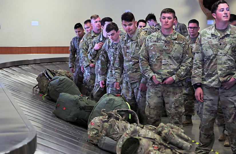 Alaska Army National Guard Soldiers assigned to 1st Battalion, 297th Infantry Regiment eagerly wait for their luggage to arrive after flying into Ted Stevens Anchorage International Airport Apr. 4, 2020. The Soldiers returned from a 9 month deployment to Kosovo for a NATO peacekeeping mission. (U.S. Army National Guard photo by Sgt. Seth LaCount/Released)