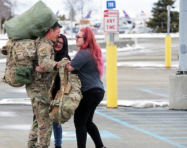 Staff Sgt. Steven Finch, an infantryman assigned to Bravo Company, 1st Battalion, 297th Infantry Regiment, Alaska Army National Guard greets his loved ones at Ted Stevens International Airport, Apr. 4, 2020. Finch returned from a 9 month deployment to Kosovo for a NATO peacekeeping mission. (U.S. Army National Guard photo by Sgt. Seth LaCount/Released)